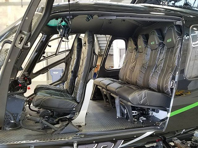 custom leather seat helicopter interior