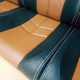 Tan upholstery with black sides panels